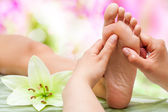 Therapist hands massaging foot. — Stock Photo