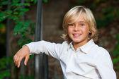 Cute blond boy outdoors. — Stock Photo