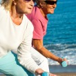 Elderly ladies doing worlout on beach. — Stock Photo