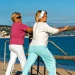 Elderly women stretching before jogging. — Stock Photo