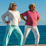 Senior women doing exercise outdoors. — Stock Photo