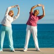 Senior women stretching at seafront. — Stock Photo #35362695