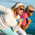Senior ladies working out on beach. — Stock Photo #35362715