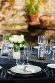 Elegant setted table outdoors. — Stock Photo
