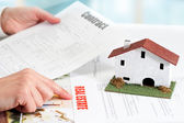 Hands reviewing real estate property documents. — Stock Photo