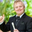 Disabled musicidoing thumbs up. — Stock Photo #38692751