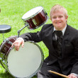 Young handicapped drummer next to drums. — Stock Photo