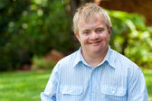 Smiling handicapped boy outdoors. — Stock Photo