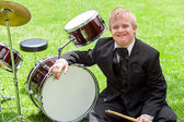 Young handicapped drummer next to drums. — Zdjęcie stockowe