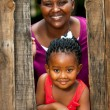 Happy african girl with mother. — Stock Photo