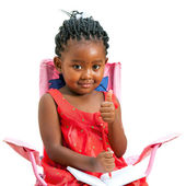 Sweet african kid with note book and thumbs up. — Stock Photo