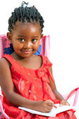 Cute little african girl drawing. — Stock Photo