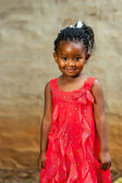 Cute african youngster in red dress. — Stock Photo