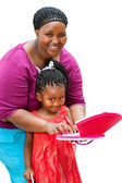 African mother helping child on laptop. — Stock Photo