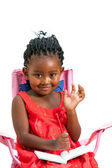 Cute african girl with note book waving hand. — Stock Photo