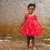 African girl showing red dress. — Stock Photo