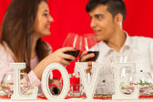 Romantic dinner table with couple in background. — Stock Photo