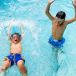 Boys having great time in pool. — Stock Photo