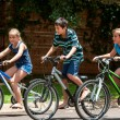 Stock Photo: Kids riding theit bisycles.