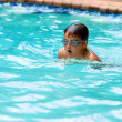 Постер, плакат: Boy practicing breaststroke in pool