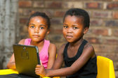 Portrait of two african youngsters with digital tablet. — Stock Photo