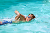 Boy practicing freestyle in pool. — Stock Photo