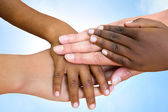 Human races joining hands. — Stock Photo