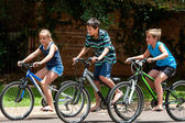Kids riding theit bisycles. — Stock Photo