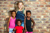 Caucasian girl with african friends. — Stock Photo