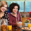Two girl friends having tea and cookies. — Stock Photo #41551045