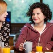 Two girls having coffee together. — Stock Photo #41551069