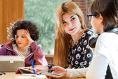 Young female students discussing homework. — Stockfoto