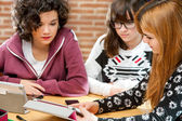 Girls sharing information on tablet.  — Stock Photo