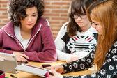 Girls sharing information on tablet.  — Stok fotoğraf
