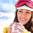 Female skier drinking coffee. — Stock Photo #42045467