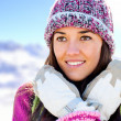 Foto Stock: Cute girl with beanie and gloves in mountains.