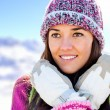 Stock Photo: Cute girl with beanie and gloves in mountains.