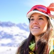 Stock Photo: Womin ski wear contemplating view.