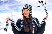 Cute girl playing with scarf in snow. — Stock Photo