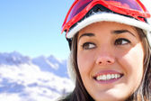 Face shot of female skier in mountains. — Stock Photo