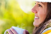 Extreme close up of girl with coffee mug outdoors. — Stock Photo