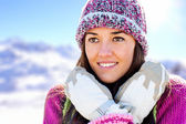 Cute girl with beanie and gloves in mountains. — Stock Photo