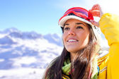 Woman in ski wear contemplating view. — Stockfoto