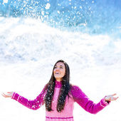 Young girl under snowflakes. — Stock Photo
