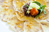 Detail of pork trotter carpaccio. — Stock Photo