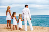 Family holding hands on beach. — Stock Photo