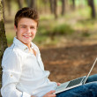 Portrait of teen boy with laptop. — Stock Photo