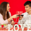 Young couple celebrating valentine's over dinner. — Stock Photo