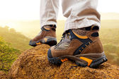 Close up of hiker boots on rocks. — Stock Photo