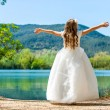 Small princess in white dress at lake. — Stock Photo #45448779